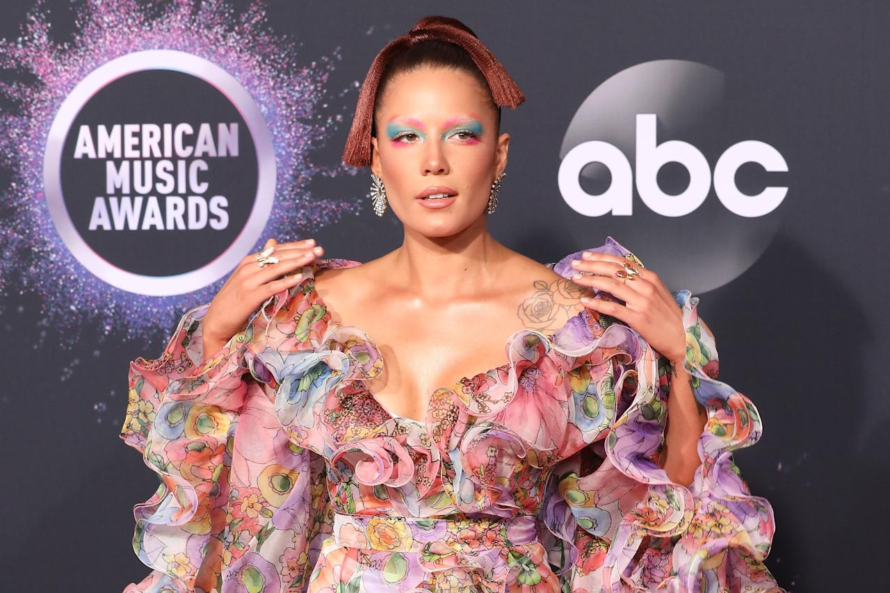 This look was Halsey at her most colorful — from the red hair to eyeshadow in two contrasting colors and the bleached brows! Halsey combined various elements to create a beautiful beauty work of art.