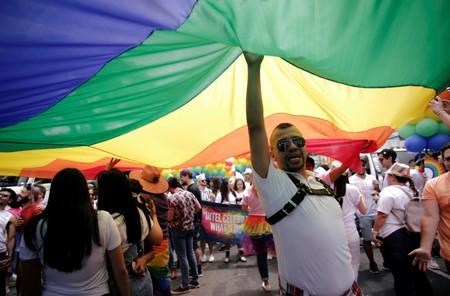 People take part in the annual Gay Pride parade along a Central Avenue, in San Jose