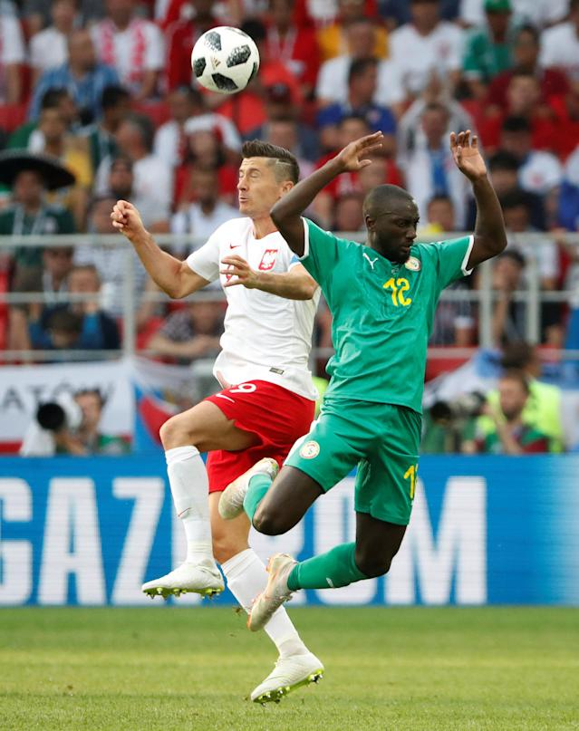 Soccer Football - World Cup - Group H - Poland vs Senegal - Spartak Stadium, Moscow, Russia - June 19, 2018 Poland's Robert Lewandowski in action with Senegal's Youssouf Sabaly REUTERS/Grigory Dukor