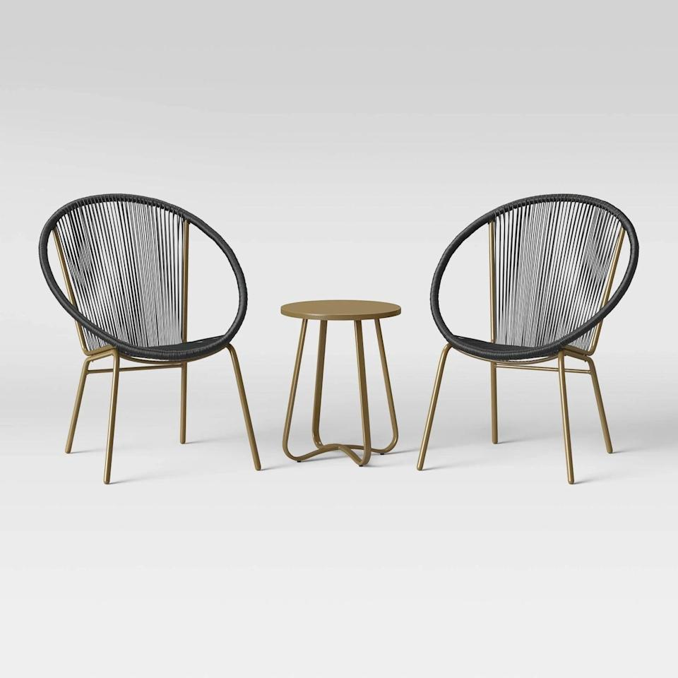 <p>If you have a modern and sleek aesthetic, the <span>Project 62 Fisher 3pc Disc Chair Small Space Set - Black/Gold</span> ($275) as a glam element that will look great with bistro-style hanging lights.</p>