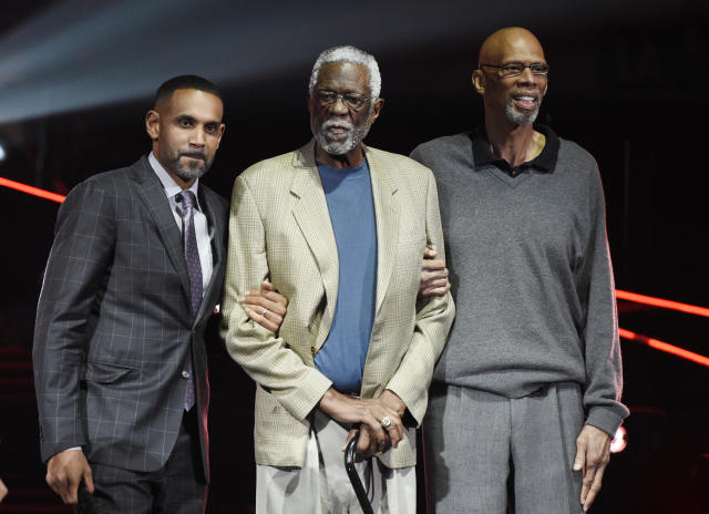 Bill Russell, center, tweeted out a photo of him kneeling in support for Stephon Clark, a Sacramento resident who was shot and killed by police earlier this month while holding a cellphone in his grandmother's back yard. (AP Photo/Chris Pizzello)