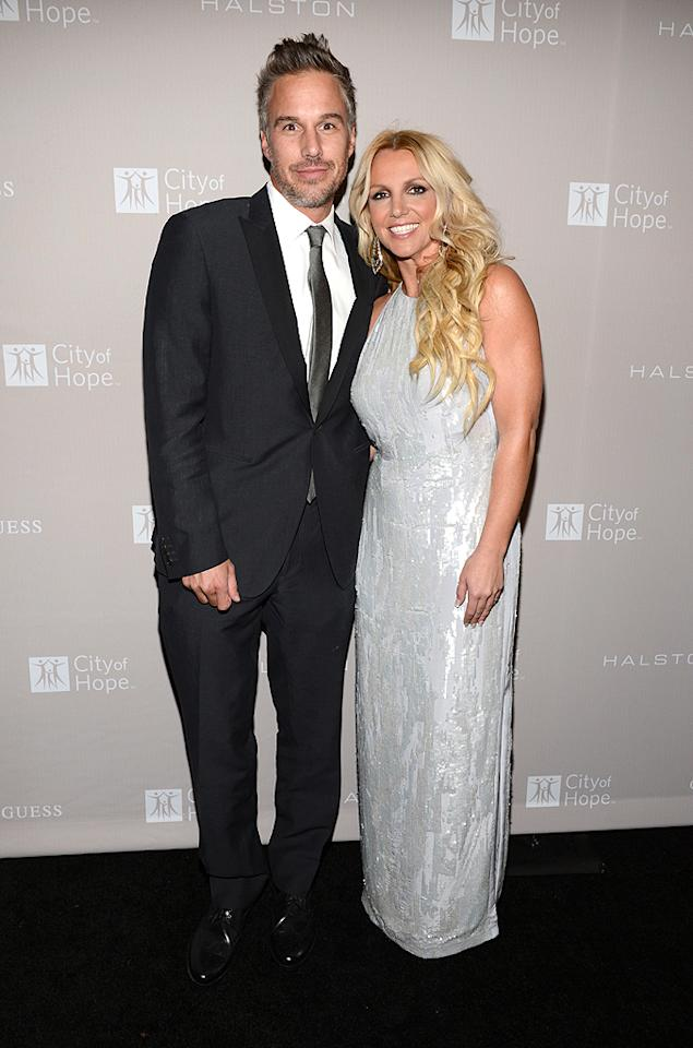 "<p class=""MsoNormal"">""X Factor"" judge Britney Spears made a rare red carpet appearance with her fiance of 10 months, Jason Trawick, to help City of Hope honor Halston CEO Ben Malka with the Spirit of Life Award at Exchange L.A. on Wednesday evening. The 30-year-old dazzled in a white sequined Halston gown and YSL heels. (10/10/12)</p>"