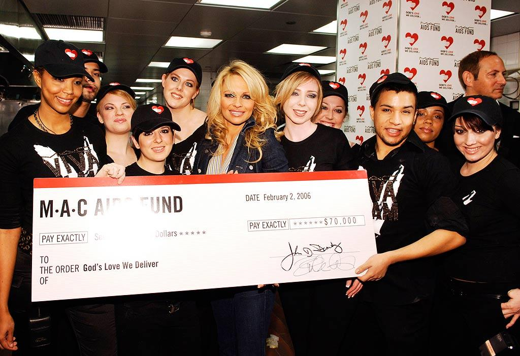 "Pamela Anderson and M.A.C. AIDS Fund donate a $70,000 check to God's Love We Deliver, a program that delivers fresh meals to people living with AIDS in New York and New Jersey. Jemal Countess/<a href=""http://www.wireimage.com"" target=""new"">WireImage.com</a> - February 2, 2006"