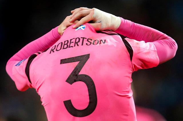 Small fish in a little pond? Liverpool's summer signing from Hull City Andrew Robertson looks dejected as Scotland fail to qualify