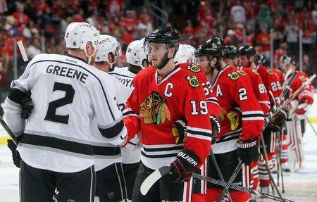 Jun 1, 2014; Chicago, IL, USA; Chicago Blackhawks center Jonathan Toews (19) shakes hands with Los Angeles Kings defenseman Matt Greene (2) after game seven of the Western Conference Final of the 2014 Stanley Cup Playoffs at United Center. Mandatory Credit: Jerry Lai-USA TODAY Sports