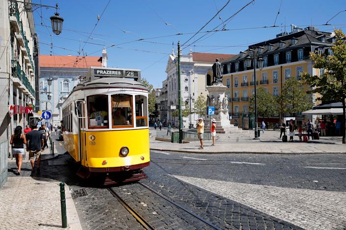 One of Lisbon's famous yellow trams, an attraction for the 4.5 million tourists who have been visiting the city each year. (Photo: Dominik Bindl via Getty Images)