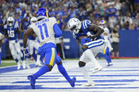 Indianapolis Colts' Zach Pascal (14) makes a touchdown reception against Los Angeles Rams' Darious Williams (11) during the second half of an NFL football game, Sunday, Sept. 19, 2021, in Indianapolis. (AP Photo/AJ Mast)