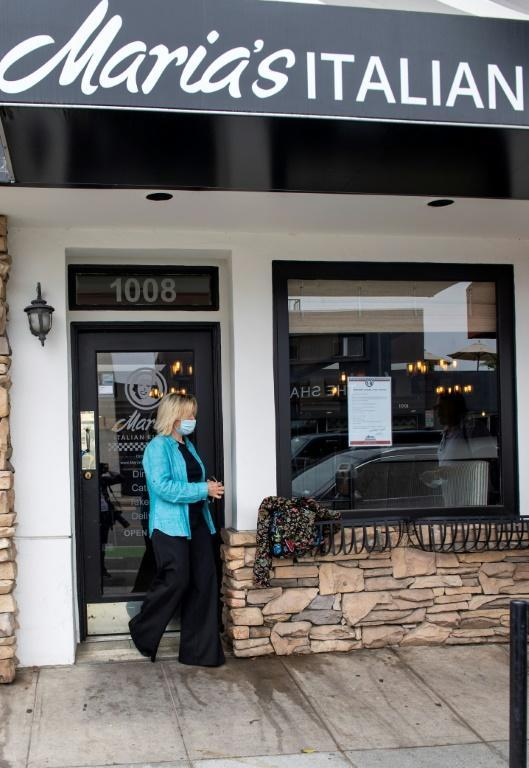 Madelyn Alfano owner of Maria's Italian Kitchen leaves her restaurant now closed due to Covid 19 pandemic, on July 28, 2020, in Santa Monica, California