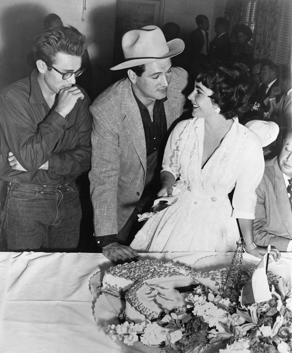 <p>Hudson shared the screen with many Hollywood power players of the time, including James Dean (L) and Elizabeth Taylor (R) in what would become one of Dean's last films, <em>Giant</em>. </p><p>For Hudson's performance in the picture, he collected an Academy Award nomination.</p>