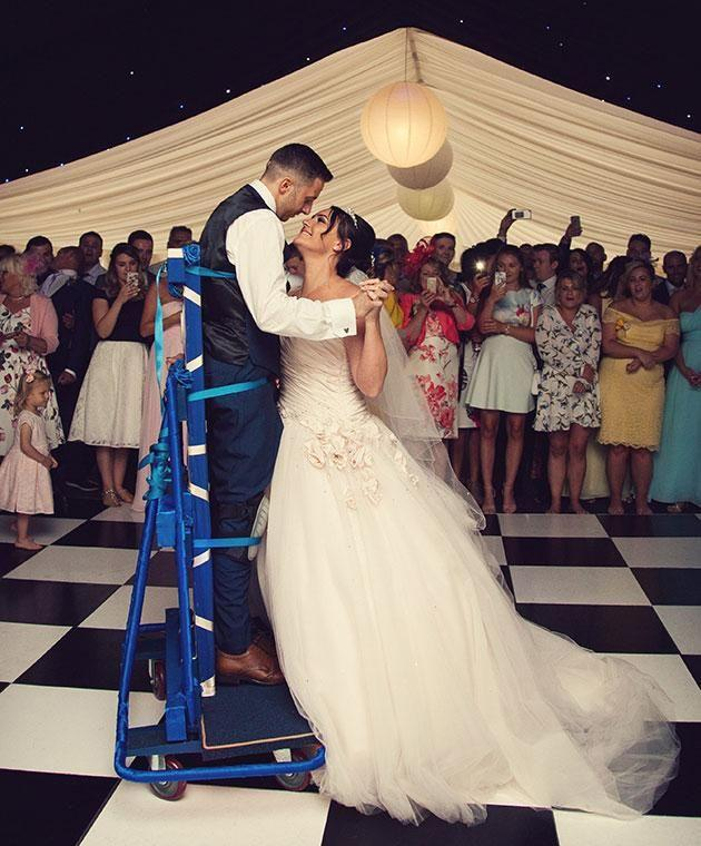 James and Michaela shared an emotional first dance using a special frame. Photo: Mega