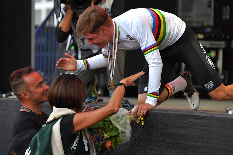 Belgium's Remco Evenepoel embraces his parents after becoming junior road race world champion at the 2018 UCI Road World Championships in Innsbruck, Austria