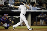 Newly acquired New York Yankees Chase Headley hits a game-winning, walk-off, RBI single off Texas Rangers reliever Nick Tepesch in a baseball game at Yankee Stadium in New York, Wednesday, July 23, 2014. (AP Photo)