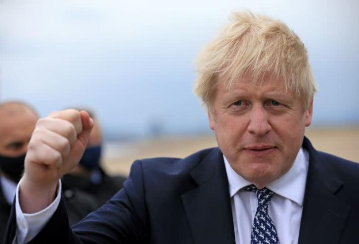 FILE PHOTO: Britain's Prime Minister Boris Johnson gestures as he campaigns on behalf of Conservative Party candidate Jill Mortimer in Hartlepool