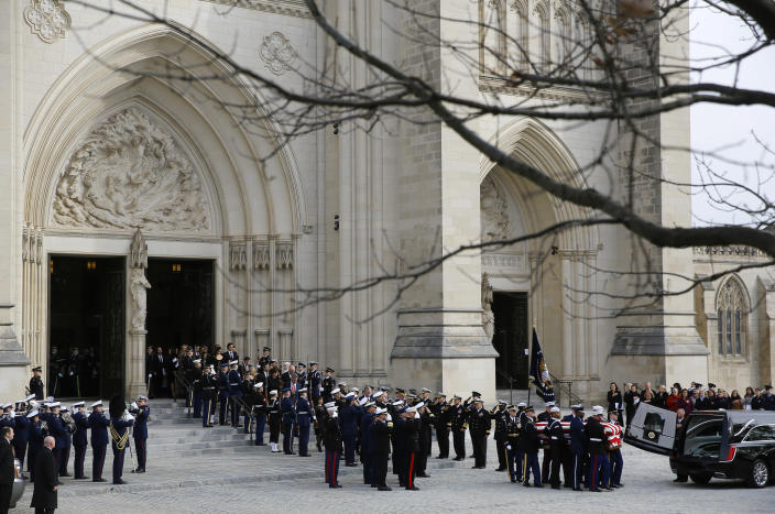 A joint services military honor guard carry the flag-draped casket of former President George H.W. Bush to a hearse after a State Funeral for former President George H.W. Bush outside the National Cathedral, Wednesday, Dec. 5, 2018, in Washington. (Photo: Patrick Semansky/AP)