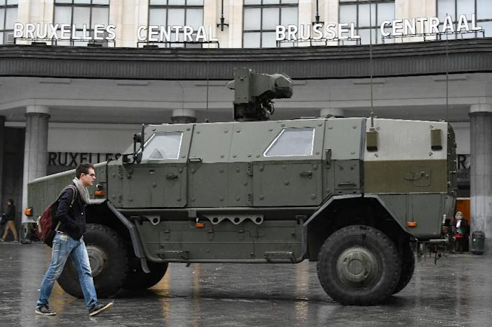 A man walks by a military vehicle parked in front of the Central Railway station in Brussels on November 21, 2015 (AFP Photo/John Thys)