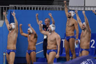 Greece players and coaches celebrate in the final moments of a win over Montenegro in a quarterfinal round men's water polo match at the 2020 Summer Olympics, Wednesday, Aug. 4, 2021, in Tokyo, Japan. (AP Photo/Mark Humphrey)