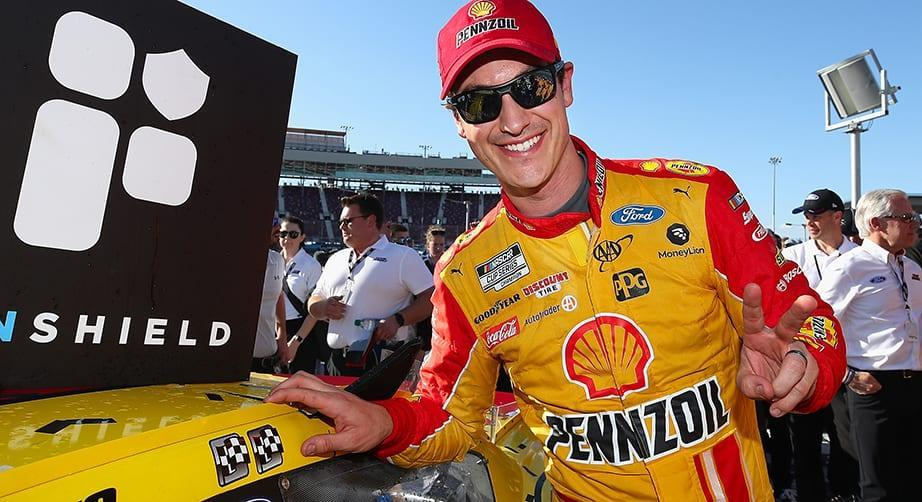 AVONDALE, ARIZONA - MARCH 08: Joey Logano, driver of the #22 Shell Pennzoil Ford, affixes the winners decal after winning the NASCAR Cup Series FanShield 500 at Phoenix Raceway on March 08, 2020 in Avondale, Arizona. (Photo by Christian Petersen/Getty Images)   Getty Images