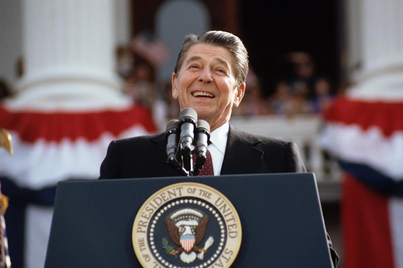 President Ronald Reagan, campaigning for a second term of office, smiles during a rally speech at the California State Capitol the day before the 1984 presidential election. (Wally McNamee/CORBIS/Corbis via Getty Images)