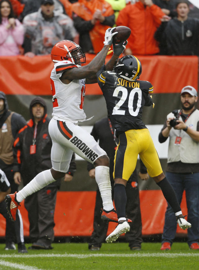 Cleveland Browns wide receiver Josh Gordon (12) catches a 17-yard touchdown pass under pressure from Pittsburgh Steelers cornerback Cameron Sutton (20) during the second half of an NFL football game, Sunday, Sept. 9, 2018, in Cleveland. (AP Photo/Ron Schwane)