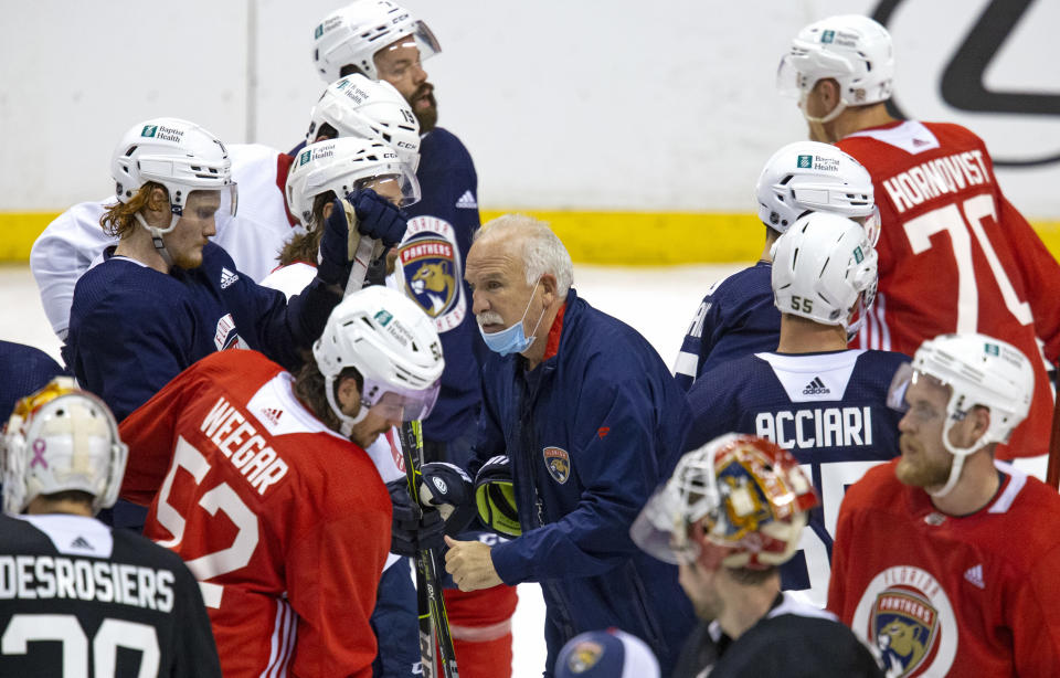 Florida Panthers head coach Joel Quenneville gives instructions to his team during NHL training camp, Wednesday, Jan. 13, 2021 in Sunrise, Fla. (David Santiago/Miami Herald via AP)