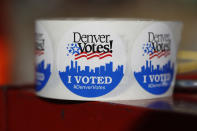 A roll of stickers handed to voters when they drop off their ballots sits at the pick-up site of the Denver Elections Division outside the City/County Building early Tuesday, Nov. 5, 2019, in Denver. (AP Photo/David Zalubowski)