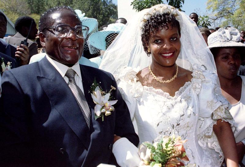 Mugabe and new wife Grace leave the Kutama Catholic Church on Aug. 17, 1996. The recent crisis arose as his hoped to extend political power to his wife as a possible successor. (Howard Burditt / Reuters)