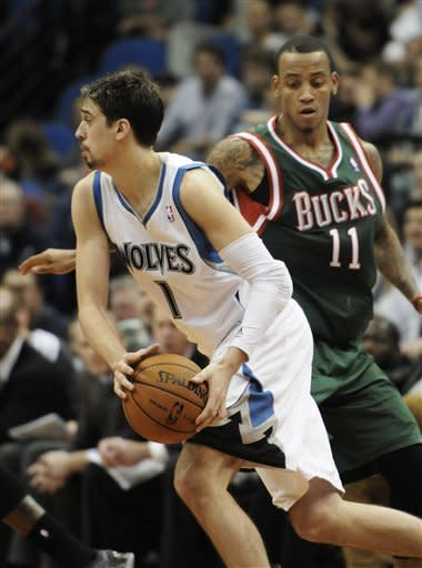 Minnesota Timberwolves' Alexey Shved, left, of Russia, passes by Milwaukee Bucks' Monta Ellis, right, in the second half of an NBA basketball game on Friday, Nov. 30, 2012, in Minneapolis. The Timberwolves won 95-85. Shved came off the bench to score 16 points. (AP Photo/Jim Mone)
