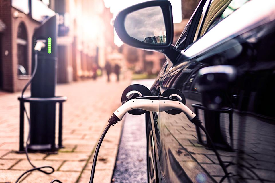 Electric Vehicle in Park Charging station in UK Street (Photo: nrqemi via Getty Images)