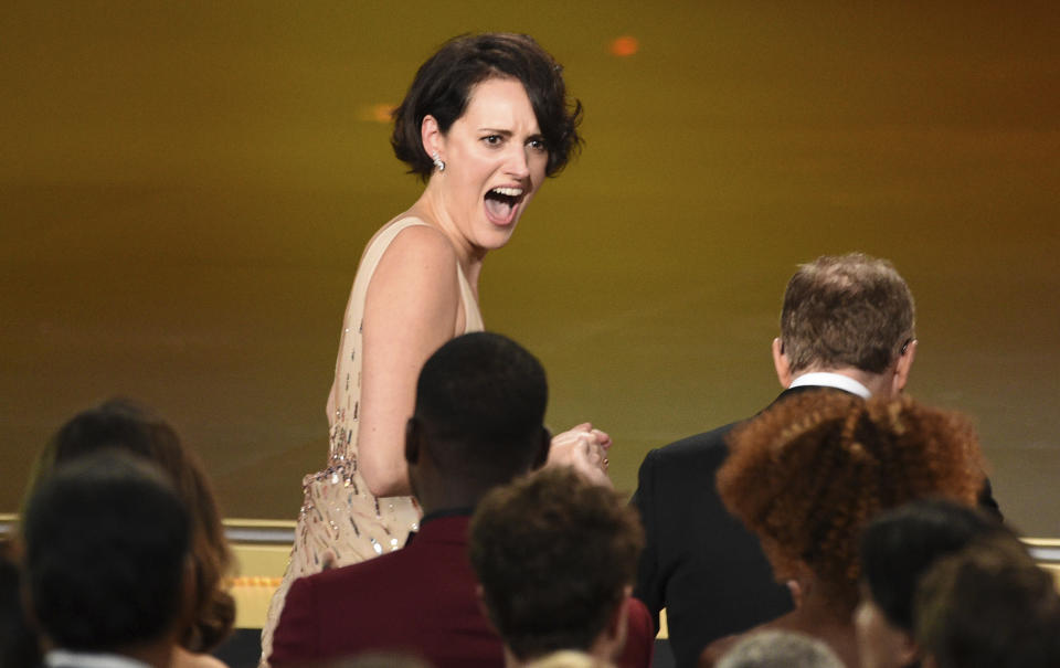 """Phoebe Waller-Bridge reacts before going on stage to accept the award for outstanding comedy series for """"Fleabag""""at the 71st Primetime Emmy Awards on Sunday, Sept. 22, 2019, at the Microsoft Theater in Los Angeles. (Photo by Chris Pizzello/Invision/AP)"""