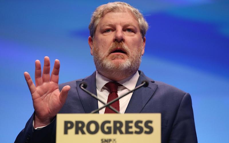 Following a backlash from members, Angus Robertson said he believed the rule change had been a mistake - Jane Barlow/PA