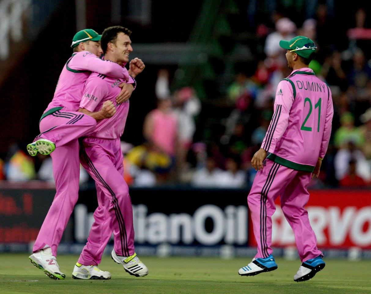 South African cricketers celebrate after taking a wicket during the 1st ODI match between India and South Africa at New Wanderers Stadium in Johannesburg on Dec.5, 2013. (Photo: IANS)