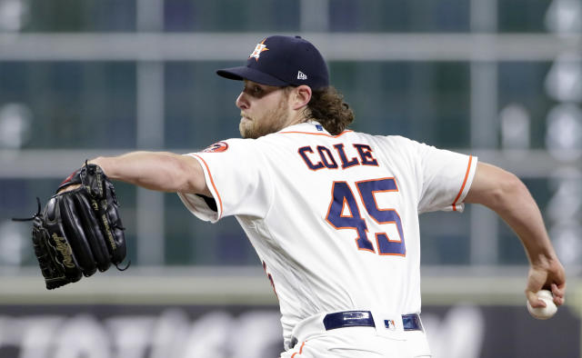 File-This Sept. 2, 2018, file photo shows Houston Astros starting pitcher Gerrit Cole (45) throwing against the Los Angeles Angels during the first inning of a baseball game in Houston. Trevor Bauer, Cole and Alex Wood have won their salary arbitration cases, giving players a 6-3 advantage over teams to ensure a winning record in consecutive years for the first time since 1979-81. Cole was given a $13.5 million salary rather than the Houston Astros' offer of $11,425,000 by Gil Vernon, Steven Wolf and Walt De Treux. (AP Photo/Michael Wyke, File)
