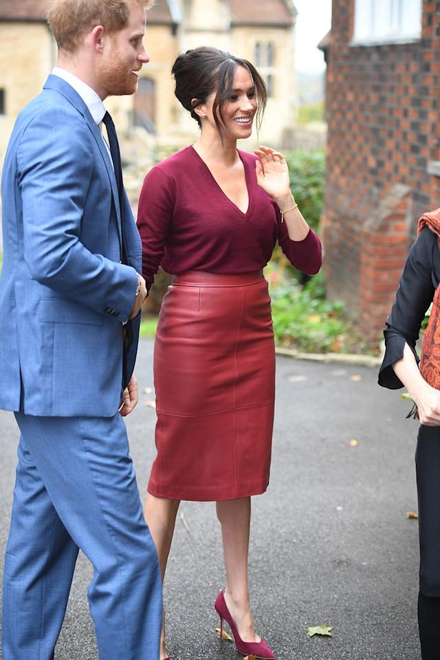 <p>Meghan Markle and Prince Harry arrived at Windsor Castle to attend a roundtable discussion on gender equality with The Queens Commonwealth Trust and One Young World in October, 2019. For the occasion, Meghan opted for a V-neck ruby red sweater, with a matching leather BOSS midi pencil skirt and suede finish court pumps. The Duchess kept her jewellery to a minimum, donning only a pair of small earrings, her rings and an understated gold bracelet.</p>