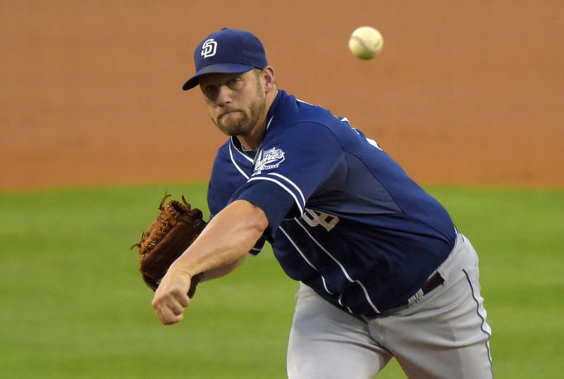 San Diego Padres starting pitcher Eric Stults throws to the plate during the first inning of a baseball game against the Los Angeles Dodgers, Wednesday, Aug. 20, 2014, in Los Angeles. (AP Photo/Mark J. Terrill)