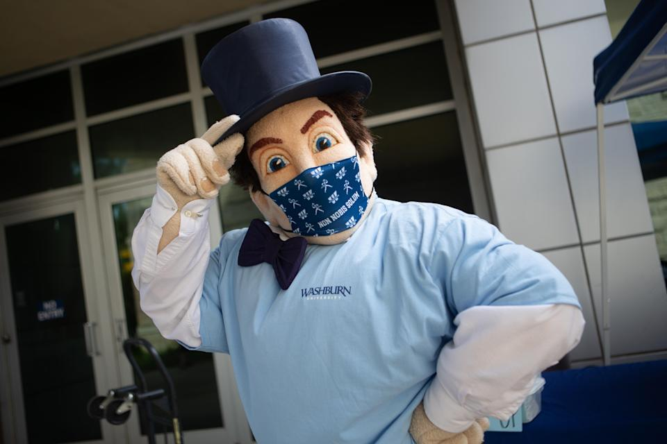 The Washburn Icabod wears one of the face masks that all students attending the university in the fall will receive during move-in day Tuesday afternoon in front of the Living Learning Center.