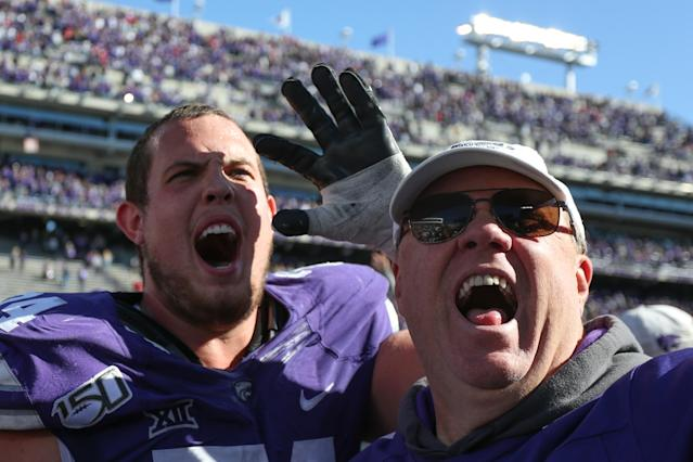 Kansas State Wildcats offensive lineman Scott Frantz (74) and his father celebrate after a 48-41 upset victory over Oklahoma in October last season. (Photo by Scott Winters/Icon Sportswire via Getty Images)