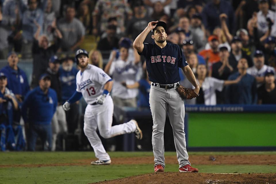 Nathan Eovaldi watches the ball leave the park as Max Muncy homered in the 18th inning to win Game 3 of the World Series, 3-2. (Getty Images)