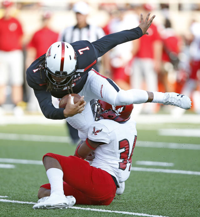 "Texas Tech's <a class=""link rapid-noclick-resp"" href=""/ncaaf/players/264525/"" data-ylk=""slk:Jett Duffey"">Jett Duffey</a> (7) was one of four Texas Tech players arrested early Sunday morning. (Brad Tollefson/Lubbock Avalanche-Journal via AP)"