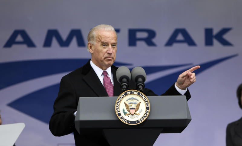 FILE - In this March 13, 2009 file photo, Vice President Joe Biden announces funding for Amtrak, at Union Station in Washington. Warning to Amtrak from Mitt Romney and Republicans: You're on your own. The platform Republicans adopted at their convention includes a call for full privatization and an end to subsidies for the nation's passenger rail operator, which gobbled up almost $1.5 billion in federal funds last year. (AP Photo/Pablo Martinez Monsivais, File)