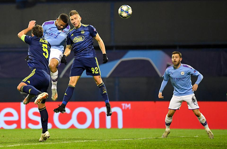 ZAGREB, CROATIA - DECEMBER 11: Gabriel Jesus of Manchester City scores his team's first goal past Damian Kadzior and Arijan Ademi of GNK Dinamo Zagreb during the UEFA Champions League group C match between Dinamo Zagreb and Manchester City at Maksimir Stadium on December 11, 2019 in Zagreb, Croatia. (Photo by Dan Mullan/Getty Images)