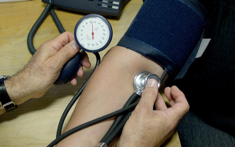 """File photo dated 10/09/14 of a doctor checking a patient's blood pressure. The number of notes issued by doctors saying someone is not fit to work due to stress-related disorders increased by 8% last year, new research suggests. PA Photo. Issue date: Monday February 10, 2020. There were 741,210 so-called """"fit notes"""" handed out due to stress, compared with 686,670 the previous year, said employment law firm GQ Littler. - Anthony Devlin/PA"""
