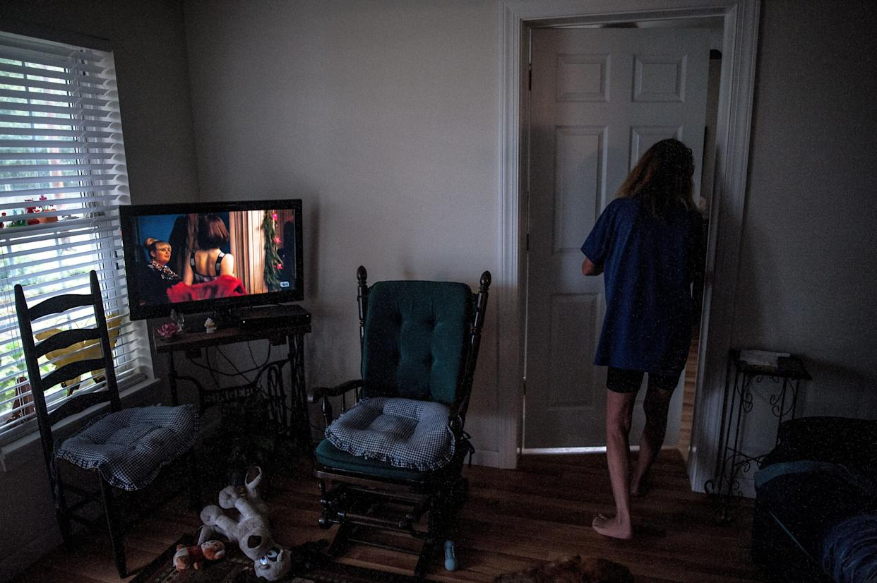 Allen walks through her home in Lumberton after deciding not to follow mandatory evacuation orders.