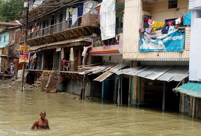 <p>A man wades through a street flooded by water from the banks of the river Ganga, in Allahabad, India, August 26, 2016. (REUTERS/Jitendra Prakash)</p>