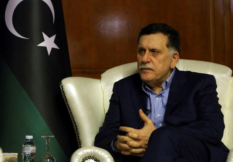 The head of Libya's Government of National Accord Fayez al-Sarraj speaks during an interview with AFP in Tripoli on November 8, 2018