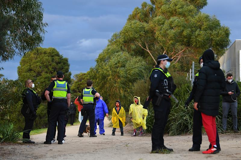 Victorian Police speak with people who are out walking near Dandenong's George Andrews Reserve on Thursday. Source: AAP