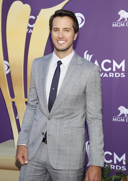 """FILE - This April 1, 2012 file photo shows country singer Luke Bryan at the 47th Annual Academy of Country Music Awards in Las Vegas. Bryan is joining Blake Shelton as co-host of the 2013 Academy of Country Music Awards on April 7. Bryan replaces Reba McEntire, who served as host for more than a decade before stepping aside to concentrate on her new sit-com """"Malibu Country."""" (AP Photo/Isaac Brekken, file)"""