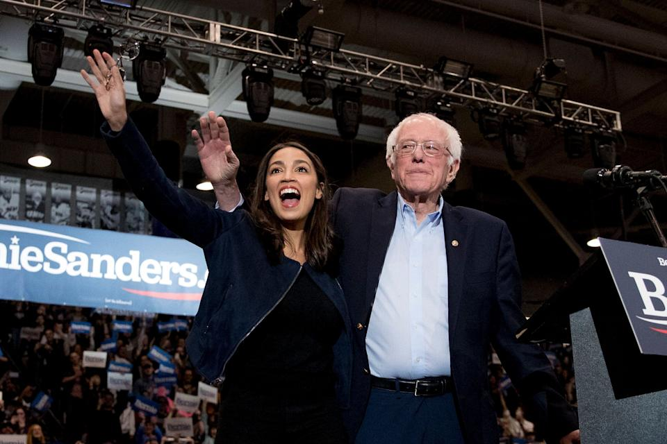 Former Democratic presidential candidate Sen. Bernie Sanders (I-Vt.) and Rep. Alexandria Ocasio-Cortez (D-N.Y.), left, take the stage at Sanders' campaign stop at the University of New Hampshire, Feb. 10. (Photo: ASSOCIATED PRESS)