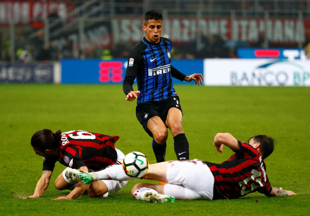 Soccer Football - Serie A - AC Milan v Inter Milan - San Siro, Milan, Italy - April 4, 2018 Inter Milan's Joao Cancelo in action with AC Milan's Ricardo Rodriguez and Alessio Romagnoli REUTERS/Tony Gentile
