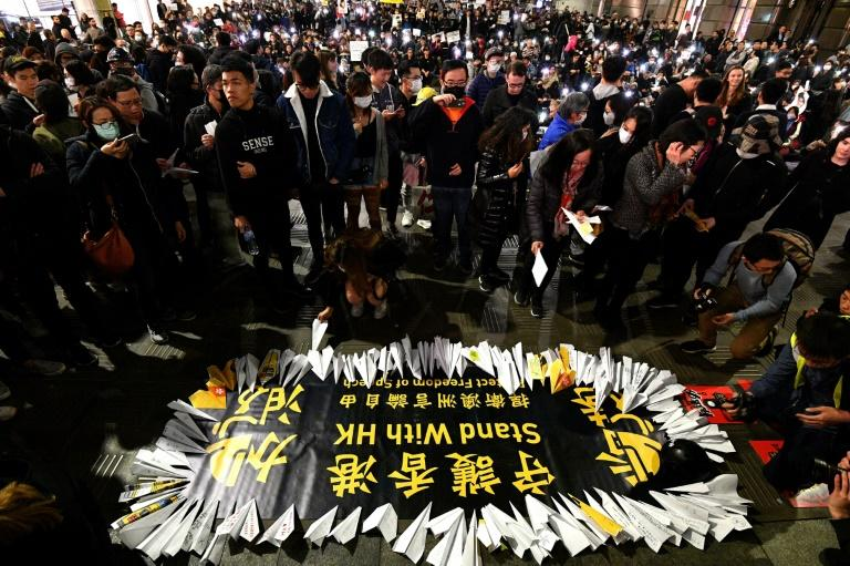Supporters of Hong Kong pro-democracy protesters demonstrated at Martin Place in Sydney (AFP Photo/Saeed KHAN)