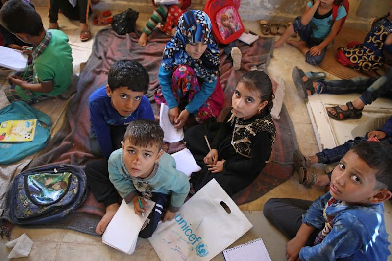 The children and their teachers have been displaced from their homes in other parts of Syria due to the seven-year war (AFP Photo/Aaref WATAD)